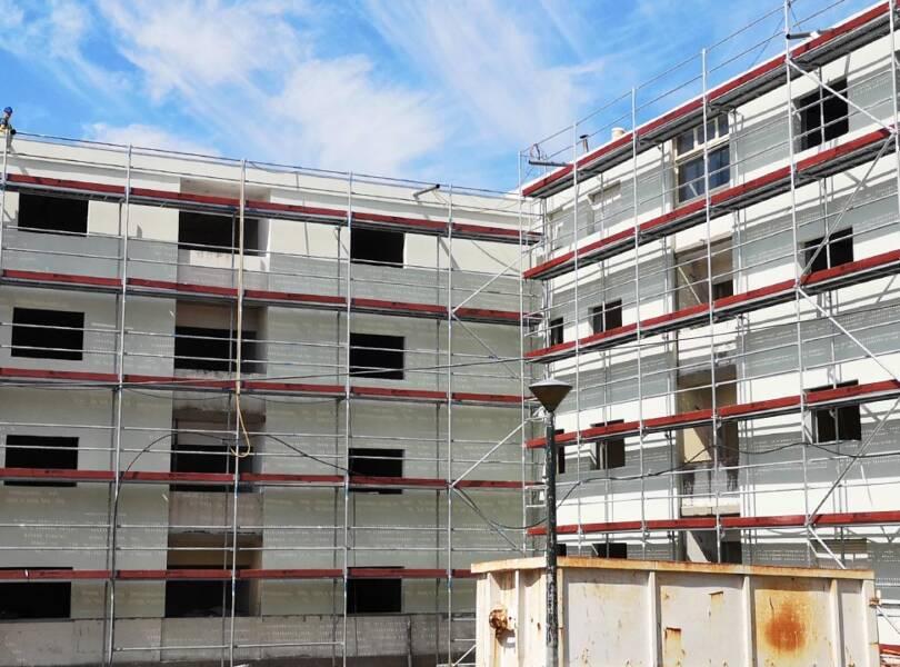 Réhabilitation d'un bâtiment mixte (commercial et résidentiel)